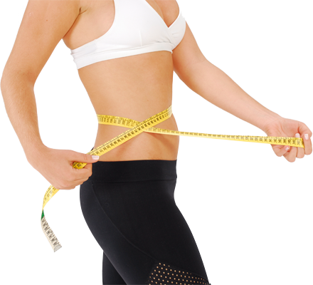 Fit woman measureing waist